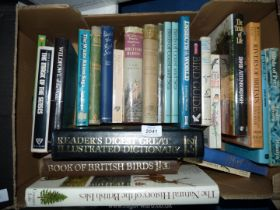 A box of books on birds, insects, wild fowl, etc.