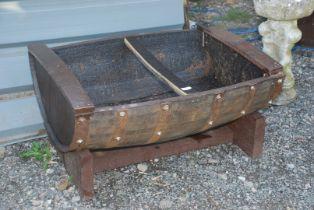 A half barrel garden planter.
