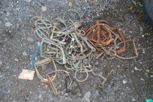 Quantity of old stirrups and horse bits.