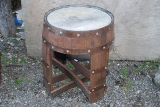 A garden table made from recycled whisky barrel.