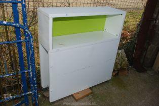 An Ikea child's headboard/storage unit.