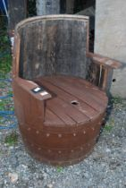A tub chair made from recycled whisky barrel.