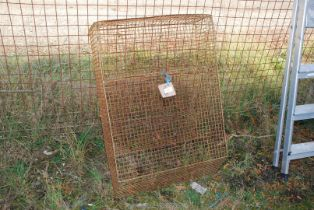 A large wire mesh office letter box.