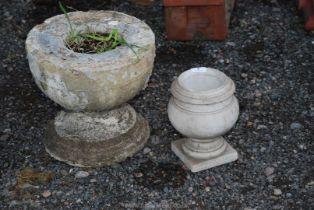 A small concrete urn and concrete planter/base.