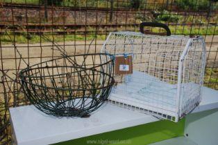 Metal pet carrier and garden baskets.