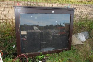 """A glazed fronted notice board with key 43 1/2"""" x 34 1/2"""" x 4""""."""