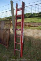 A wooden seven rung double extension ladder.