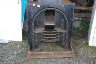 """A metal fire grate and curb 33"""" wide x 36"""" high x 10"""" deep."""
