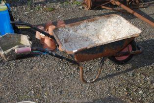 Metal builders barrow with pneumatic tyre.