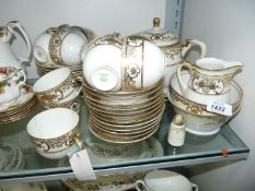 A Noritake Teaset in cream and gilding including teapot, eleven cups, twelve saucers and tea plates,