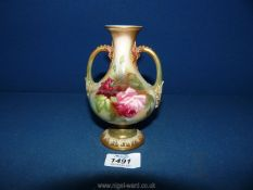 A Royal Worcester baluster shaped footed Vase with two handles decorated with pink roses with