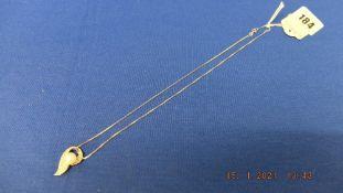 A 9ct white gold diamond pearl set pendant on chain