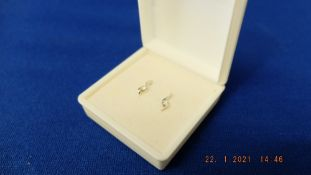 A pair of 18ct white gold diamond stud earrings