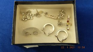 Four pairs of silver,