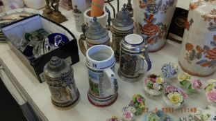 Five assorted beer steins