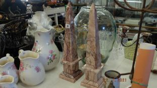 A pair of marble obelisks