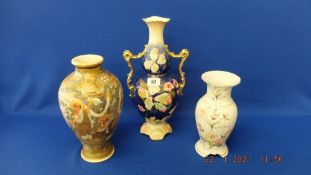 An oriental vase and a two handled vase plus another