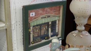 A framed model flower shop