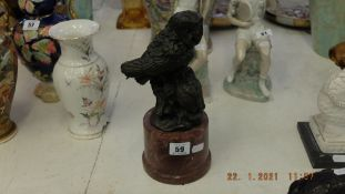 A bronze of two Owls on marble base