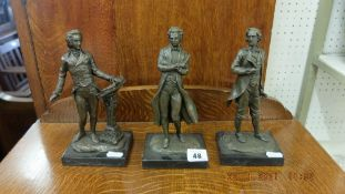 A bronze set of three Composers