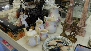 A qty of pottery jugs and a teapot