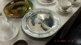 Eight Royal Doulton character plates