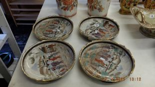 Four porcelain fruit bowls