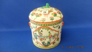 A lidded biscuit barrel