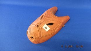 A Terracotta African mask signed Mandana inside