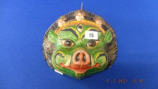 An oriental wooden/ painted mask a.