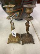 A pair of brass Cherub candlesticks
