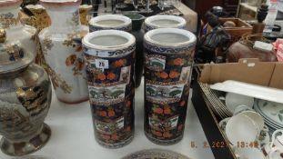 Four Imari style cylindrical vases