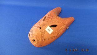 A Terracotta African mask signed Mandana inside