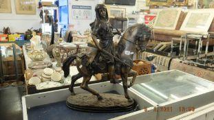 A bronze Arab man on horseback