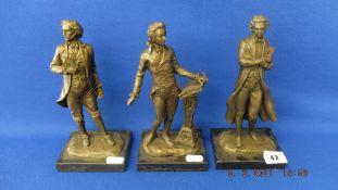 A bronze set of three Composers