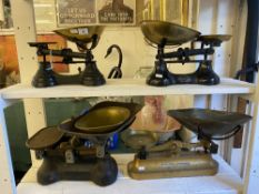 A set of four early brass and metal scales