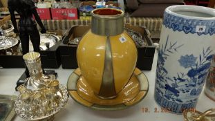 A decorative bowl and a vase