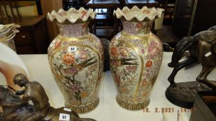 A pair of Satsuma style vases