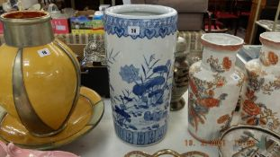 A blue and white stick stand, badly damaged,