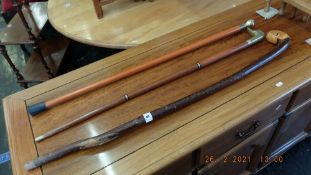 Three assorted walking sticks