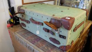 A leather bound cabin trunk