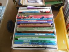 An assortment of children's annuals and racing books