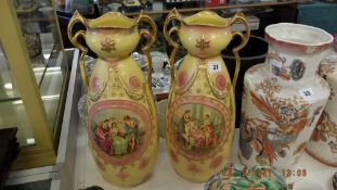 A pair of late 19th century painted decorative vases