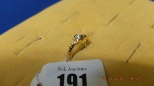 An 18ct gold diamond ring diamond centre stone and triangular diamond on shoulders
