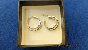 A pair of hallmarked 9ct white gold triple hoop diamond set earrings