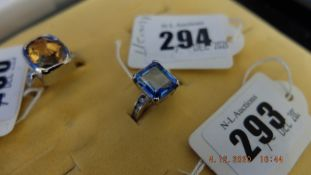 An 14ct white gold and aquamarine ring with ten diamonds on shoulder