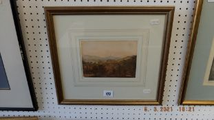 A framed and glazed watercolour landscape