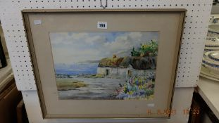 A framed watercolour, Cottages,