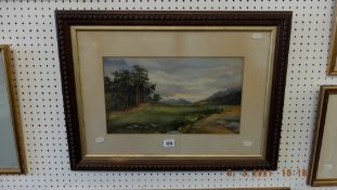 A watercolour landscape signed and dated 1901
