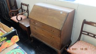 An oak bureau with three drawers
